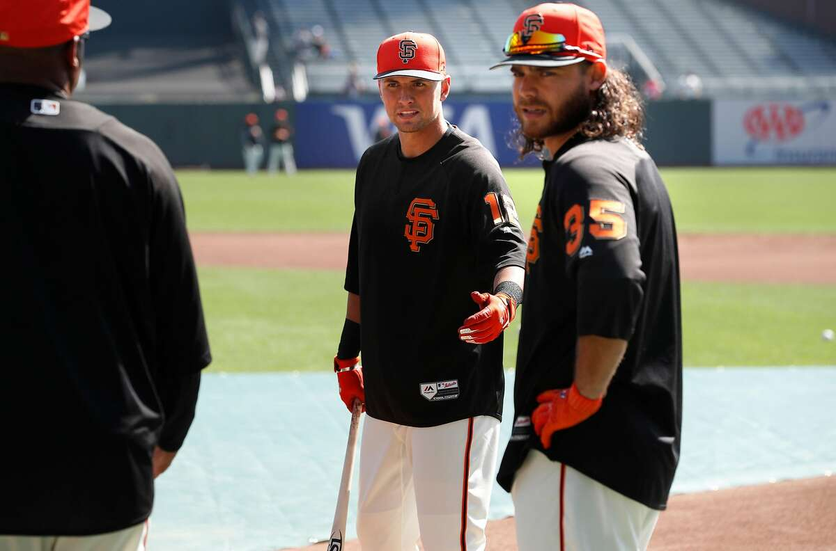Giants' Joe Panik and Brandon Crawford at batting practice during the home opener for the San Francisco Giants as they prepare to take on the Seattle Mariners at AT&T Park in San Francisco, Calif., on Tues. April. 3, 2018.