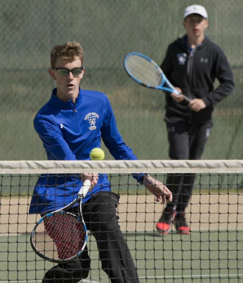 Trinity's Porter Hankins returns a shot during doubles play with Blake Carney 04/04/18 during TAPPS 1-3A district tennis tournament at the Midland College courts. Tim Fischer/Reporter-Telegram Photo: Tim Fischer/Midland Reporter-Telegram