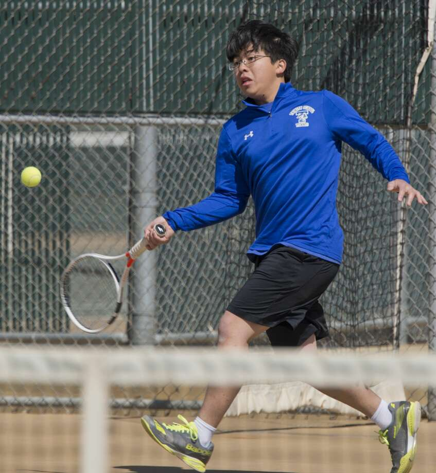 Trinity's Curtis Wong returns a shot 04/04/18 during TAPPS 1-3A district tennis tournament at the Midland College courts. Tim Fischer/Reporter-Telegram Photo: Tim Fischer/Midland Reporter-Telegram