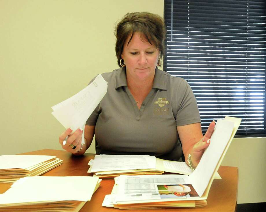 Executive Director Marie Holmes reviewed essays in 2012 from students hoping for a scholarship from the Cy-Fair Educational Foundation. Over the past 48 years, the nonprofit organization has awarded millions in scholarships. Since the organization's inception, the foundation has awarded more than $7.5 million in scholarships to graduating seniors from Cy-Fair ISD. Photo: David Hopper, Freelance / freelance