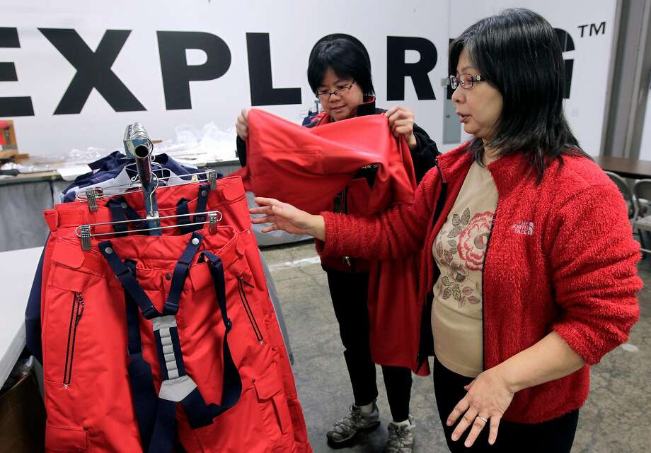 "Seamstress Betty Beh (left) and supervisor Lydia Lam inspect a line of outerwear designed for the U.S. Olympic free-skiing team at the North Face development center in San Leandro in 2014. This week, the company announced a campaign aimed at ""celebrating and sharing the stories of adventurous and courageous female explorers."". Photo: Paul Chinn / The Chronicle 2014"