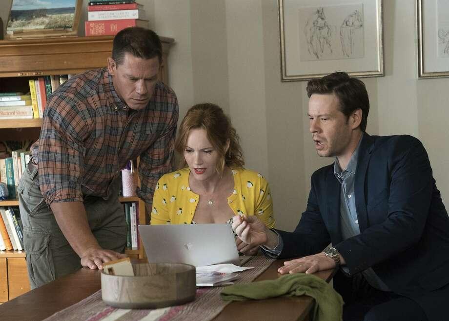 "John Cena (left), Leslie Mann and Ike Barinholtz in ""Blockers."" Photo: Quantrell D. Colbert / Universal Pictures"