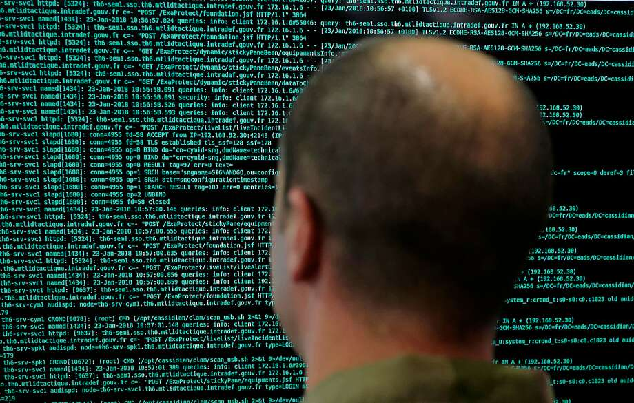 FILE - In this file photo taken on Jan. 23 2018, a solider watches code lines on his computer screen at the French Defense ministry stand during the International Cybersecurity forum in Lille, northern France. France has flagged more than 78,000 people as security threats in a database intended to let European police share information on the continent's most dangerous residents _ more than all other European countries put together _ according to an analysis by The Associated Press. (AP Photo/Michel Spingler, File) Photo: Michel Spingler, Associated Press