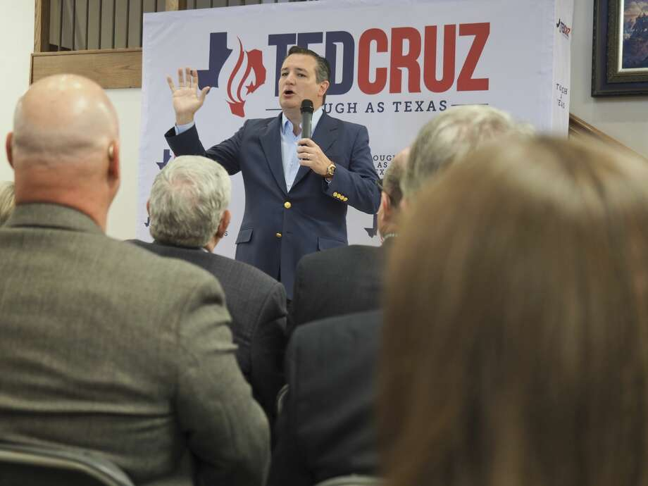 "U.S. Sen. Ted Cruz was trolled by a woman in Austin who asked if he would ""submit to a DNA test, to prove that he's human."" Cruz, shown in Midland, toured Texas on Tuesday.Scroll ahead to see more of Cruz's campaign stop in Midland. Photo: Tim Fischer/Midland Reporter-Telegram"
