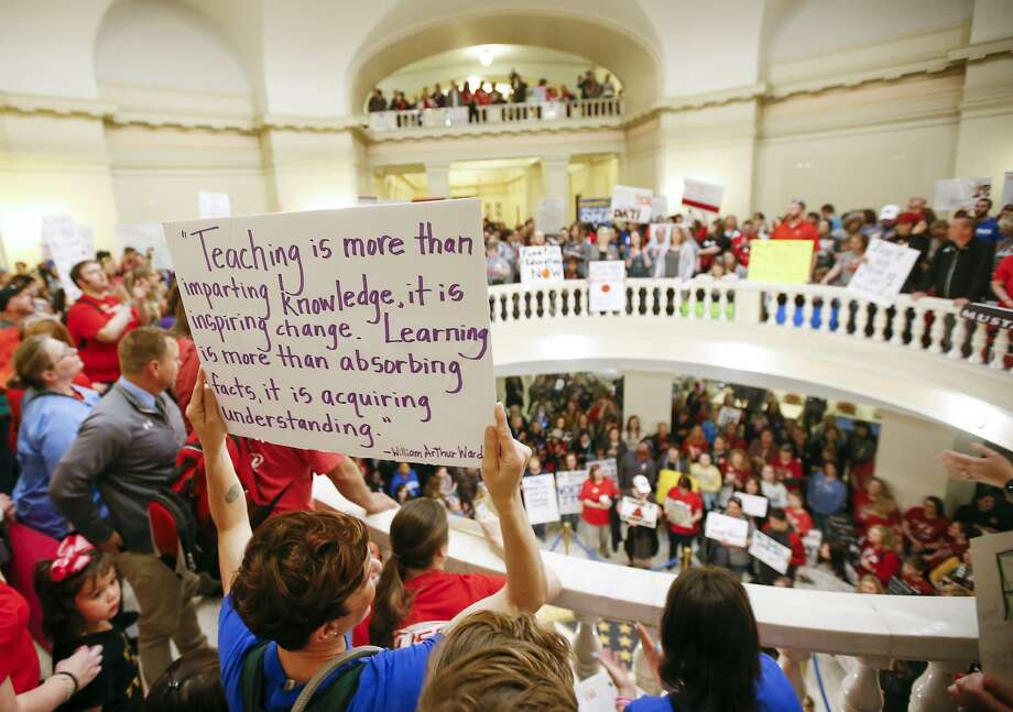 Oklahoma teachers and supporters of increased education funding pack the state Capitol during a walkout in Oklahoma City. Teachers also want more funding for classrooms. Photo: Nate Billings / Associated Press