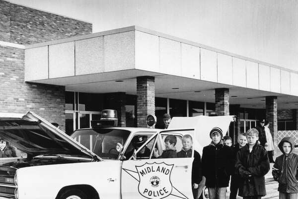 Four hundred Midland area youngsters were guests of the Midland Police Department at Studio M, where special cartoons and films were shown. Some of the early arrivals spent time viewing the cruiser and becoming acquainted with their friendly hosts, Midland Police officers. December 1968