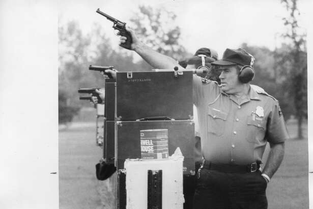 Lt. James Newton begins to lower weapon as he draws aim on target. November 1975
