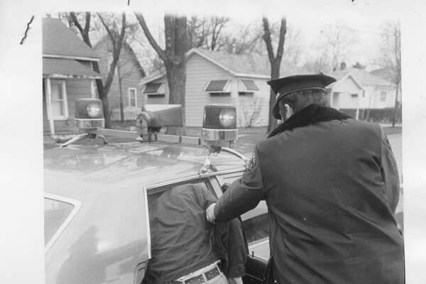 Upon arrest, the motorist faces a ride in the back seat of a squad car to the county jail.  People used in these posed photos were innocent participants and were not being charged with the offense. Illustration photo in April 1974 Daily News story on what happens if stopped for driving under the influence of liquor. April 1974