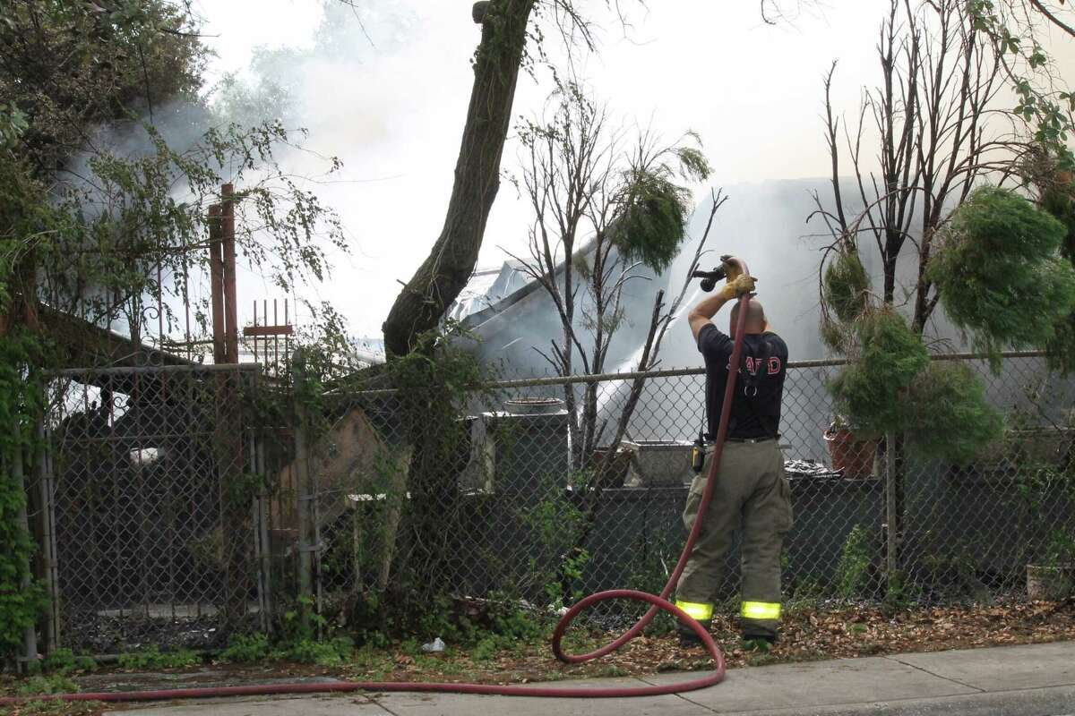 More than a dozen fire crews are responding to a house fire in the 500 block of Ceralvo Street.