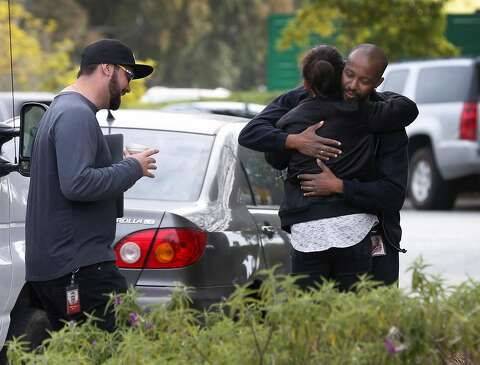 691be208e683 Unidentified employees hug outside of YouTube headquarters in San Bruno