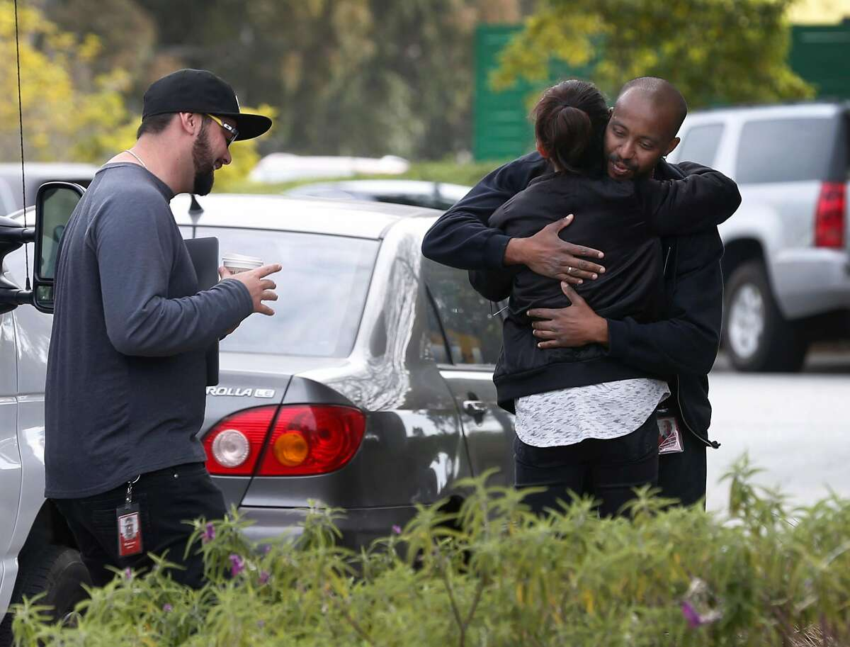 Unidentified employees hug outside of YouTube headquarters in San Bruno, Calif. on Wednesday, April 4, 2018. On Tuesday, disgruntled video maker Nasim Aghdam shot and wounded three YouTube employees before turning the gun on herself.