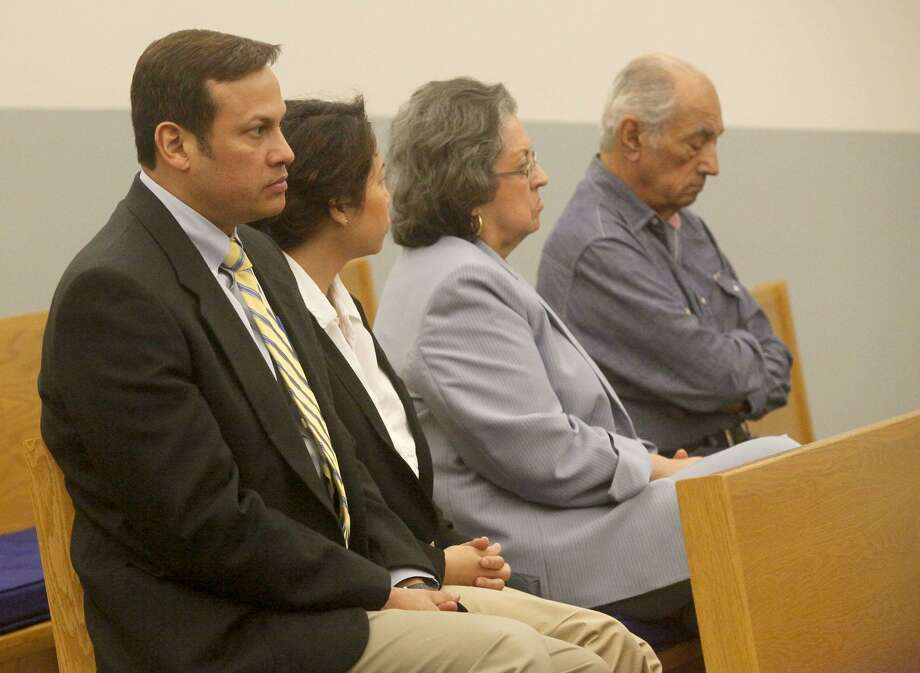 Former San Antonio attorney Mark Benavides (left) sits in court Tuesday in Floresville. He was convicted Tuesday evening on six counts of continuous trafficking of persons. Photo: John Davenport /San Antonio Express-News / ©John Davenport/San Antonio Express-News