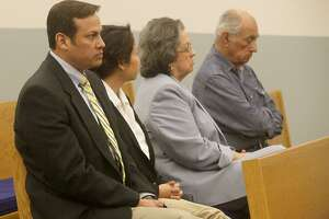 Former San Antonio attorney Mark Benavides (left) sits in court Tuesday in Floresville. He was convicted Tuesday evening on six counts of continuous trafficking of persons.