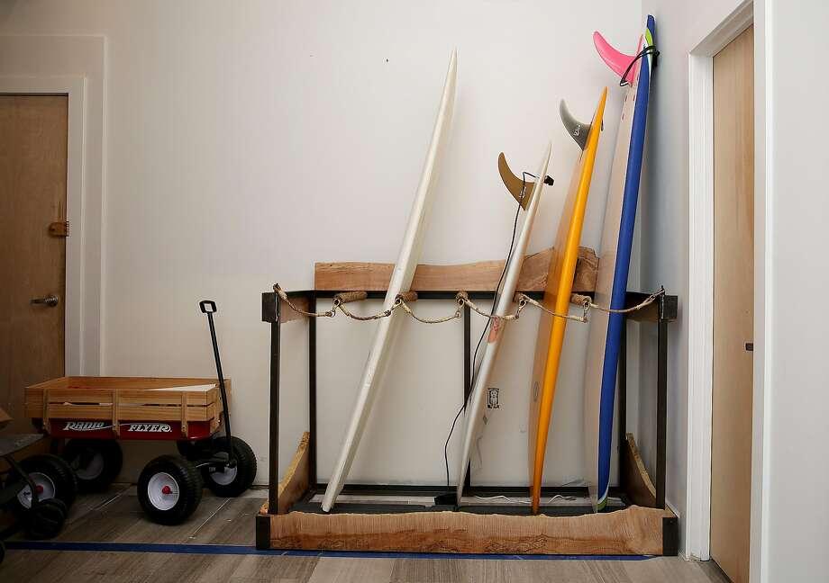 Scott Clark's surfboards at their North Beach apartment. Photo: Liz Hafalia / The Chronicle