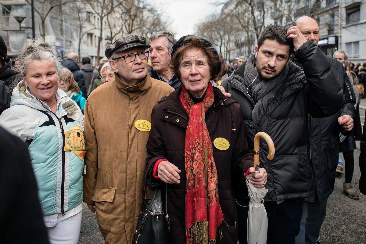 Serge and Beate Klarsfeld, center, take part in the Silent March in Memory of Mireille Knoll, 85, a Holocaust survivor who was murdered in her home on March 28 in Paris.
