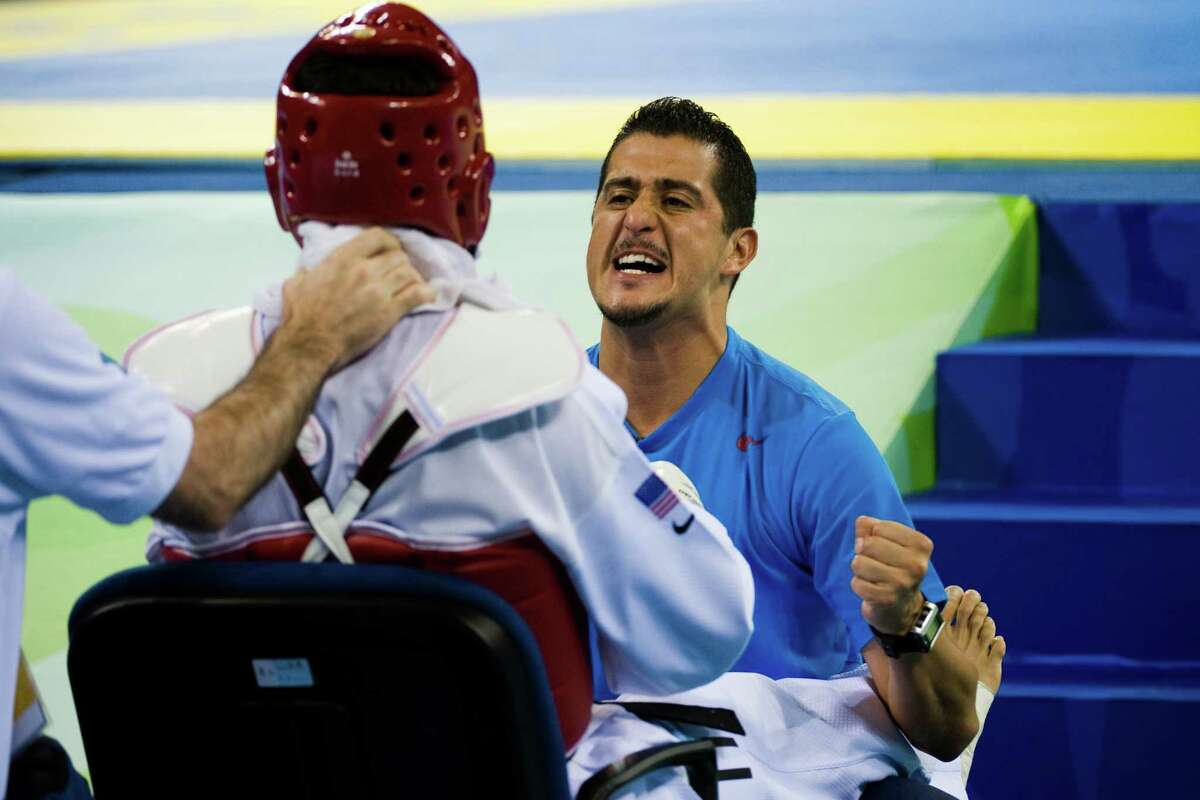 PHOTOS: 2018 Year in Sports photos Coach Jean Lopez encourages Steven Lopez of Sugar Land, Texas between rounds as he defeats N'guessan Sebastien Konan during 80kg taekwondo repechage at the 2008 Summer Olympic Games, Friday, Aug. 22, 2008, in Beijing. ( Smiley N. Pool / Chronicle ) >>>Browse through the gallery for a look at some of the best sports photos from 2018 ...