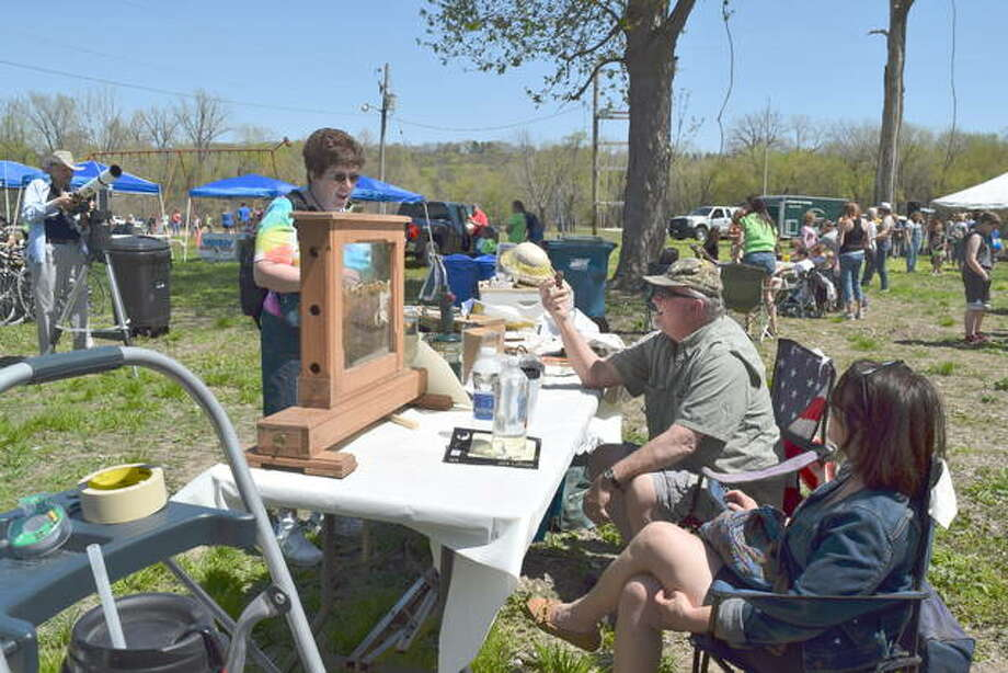 Festival-goers take in all there is to see and do at a past Riverbend Earth Day Festival. Photo: For The Telegraph