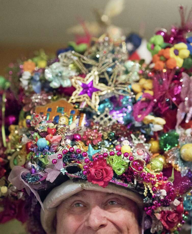Cal Sumner, known as the Fiesta Hat King, is retiring after more than 30 years of wearing a dynamically decorated hat for Fiesta. Fiesta 2018 will be Sumner's last as the unofficial Fiesta monarch. Photo: Darren Abate / For The Express-News