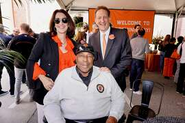 Giants great Willie McCovey (center) joins Pam Baer and her husband, Giants CEO Larry Baer at AT&T park for the Giants home opener. April 3, 2018.