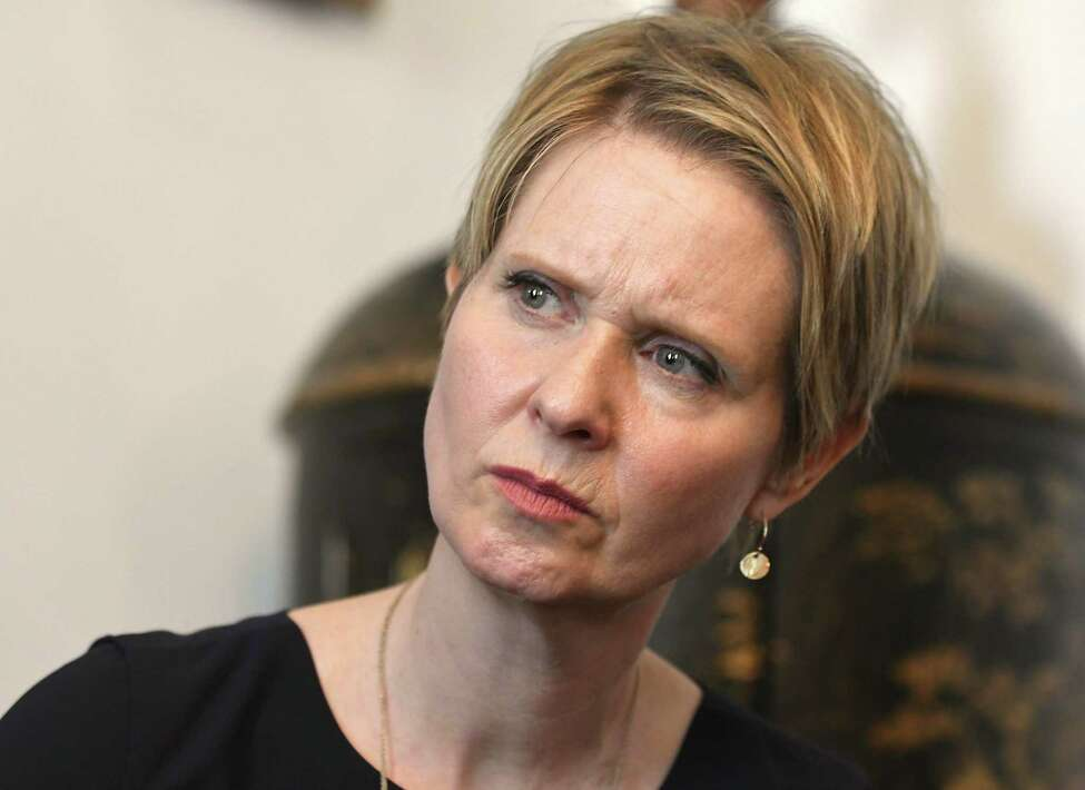 Gubernatorial candidate Cynthia Nixon listens to a Hoosick Falls resident speak at the Delaney Hotel on Wednesday, April 5, 2018 in Hoosick Falls, N.Y. Nixon and former U.S. Environmental Protection Agency Regional Administrator Judith Enck answered questions from residents who were affected by their water supplies being polluted with a toxic manufacturing chemical four years ago. (Lori Van Buren/Times Union)