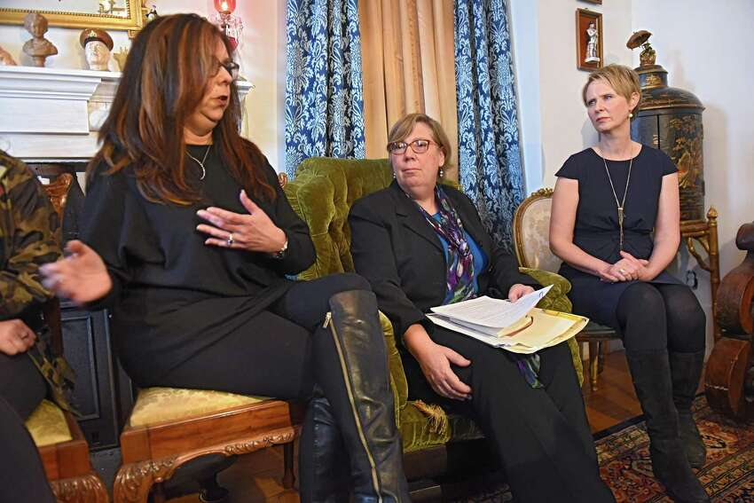 Michele Baker of Hoosick Falls talks about her experience as gubernatorial candidate Cynthia Nixon, right, and former U.S. Environmental Protection Agency Regional Administrator Judith Enck, center, hold a news conference at the Delaney Hotel on Wednesday, April 5, 2018 in Hoosick Falls, N.Y. The two answered questions from residents who were affected by their water supplies being polluted with a toxic manufacturing chemical four years ago. (Lori Van Buren/Times Union)