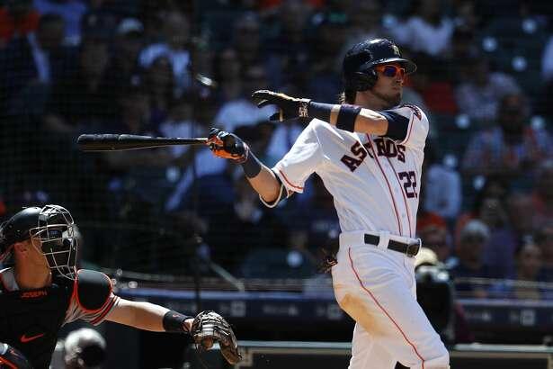 Houston Astros Josh Reddick (22) hits a single during the fourth inning of an MLB baseball game at Minute Maid Park, Wednesday, April 4, 2018, in Houston.   ( Karen Warren / Houston Chronicle )