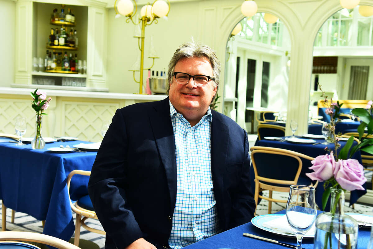 Celebrity chef David Burke, the new culinary director of the Saratoga Springs-based Adelphi Hospitality Group, poses in the dining room of The Blue Hen, the restaurant in the company's Adelphi Hotel in downtown Saratoga. Burke, associated with many top restaurants in New York City and elsewhere over the past 30 years, will supervise food service in the hotel's restaurant, called The Blue Hen; its bar, Morrissey's Lounge; catering operations; and the company's next-door steakhouse, Salt & Char. New menus are being introduced this week. (Photo by Steve Barnes/Times Union.)