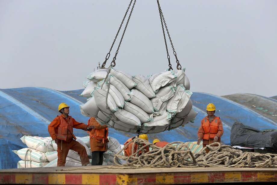 Workers load imported soybeans in China. The U.S. product is among the top targets of Chinese tariffs. Photo: Chinatopix