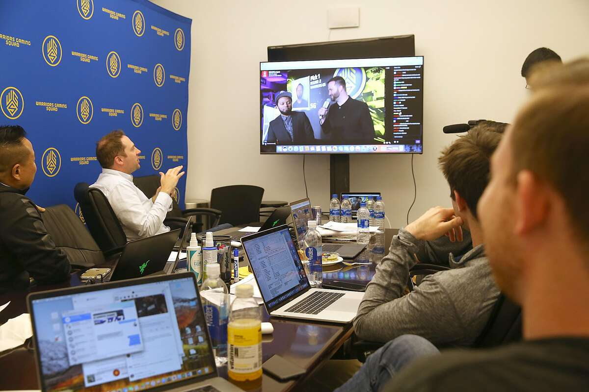 The Warriors' Gaming Squad gather at the Warriors offices in downtown Oakland to watch the proceedings on a screen and decided on Alex Reese Bsmoove as a first pick during the second round on Wednesday, April 4, 2018, in Oakland, Calif.