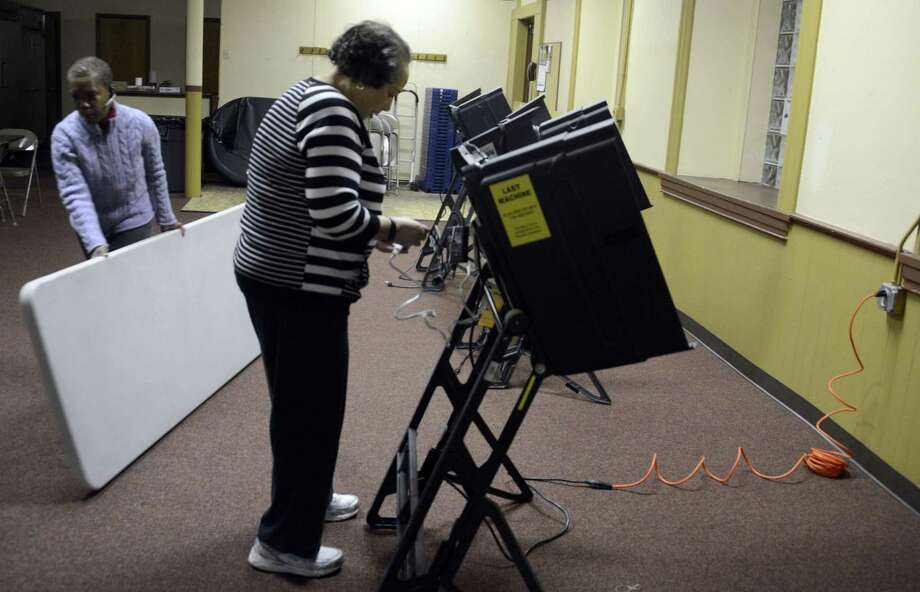 Voters at the polls in Pittsburgh in 2014. Pennsylvania could be a key battleground state in the 2016 presidential election, but the commonwealth still employs 1980s-era voting machines that could be vulnerable to hacking. Photo: Darrell Sapp,  MBR / TNS / Pittsburgh Post-Gazette