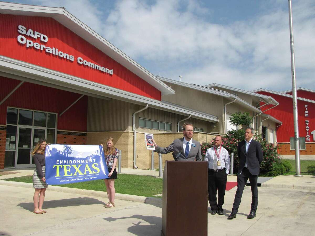 Luke Metzger, director of Environment Texas, speaks to media about San Antonio's ranking in U.S. solar installations by city. San Antonio ranked No. 6 in 2017. The fire station in the background has a solar installation installed on its roof.