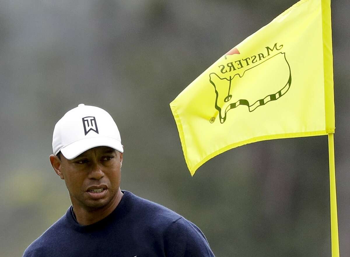 Tiger Woods looks over a putt on the first hole during a practice round for the Masters golf tournament Wednesday, April 4, 2018, in Augusta, Ga.