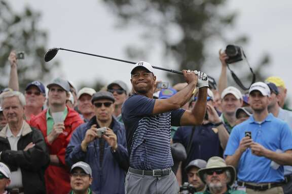 Tiger Woods hits on the eighth tee during a practice round for the Masters golf tournament Wednesday, April 4, 2018, in Augusta, Ga. (AP Photo/David J. Phillip)
