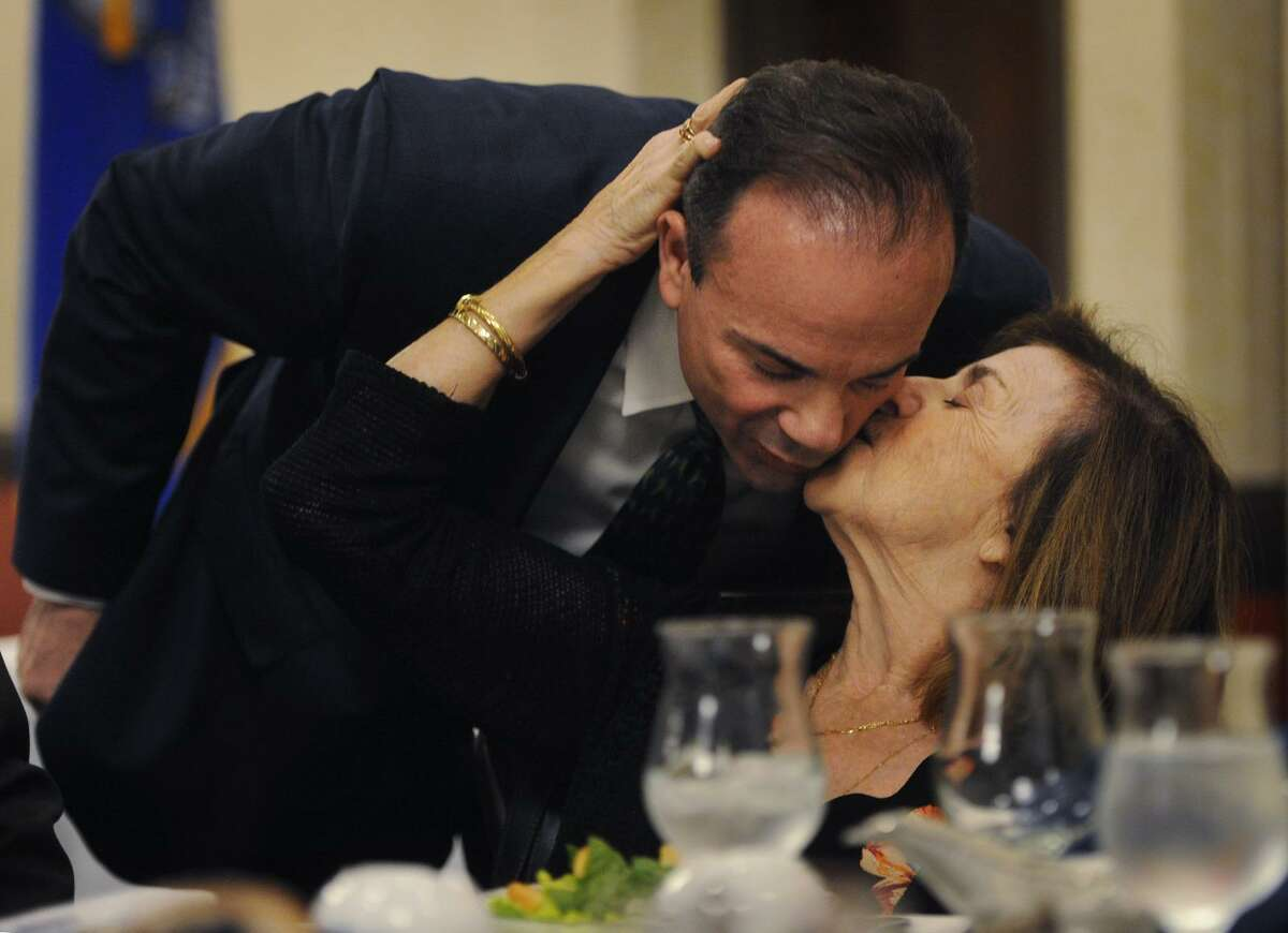 Bridgeport Mayor Joe Ganim gets a kiss from his mother, Josephine Ganim, before delivering the annual State of the City speech to members of the business community at the Holiday Inn in Bridgeport, Conn. on Wednesday, April 4, 2018.