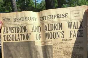 "Dustyn Myatt, of Kirbyville, holds up a copy of the Beaumont Enterprise, dated July 21, 1969, reporting the news of astronauts Neil Armstrong and Edwin ""Buzz"" Aldrin's landing and walking on the moon. The headline read, ""Armstrong and Aldwin walk 'desolation' of moon's face."" Myatt, a demolition contractor, discovered the newspaper in a stash while working on a home Wednesday in Vidor. (Dustyn Myatt/Special to The Enterprise)"