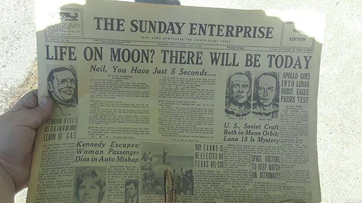 Dustyn Myatt, of Kirbyville, holds up a copy of the Beaumont Enterprise, dated July 20, 1969, reporting the news of astronauts Neil Armstrong and Edwin