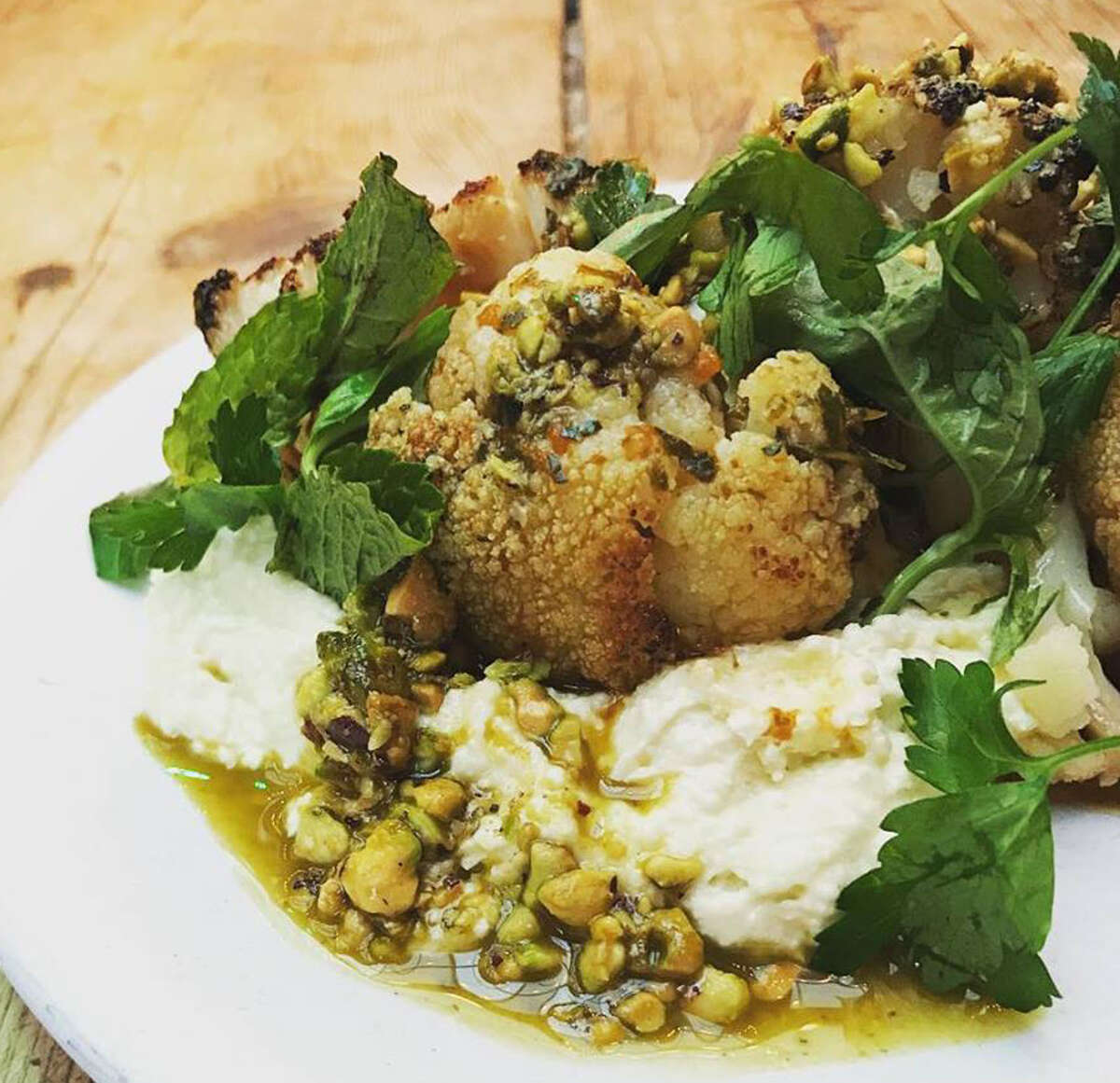 Grilled cauliflower with whipped feta, pistachio and chermoula at Peck's Arcade in Troy. (Provided photo.)