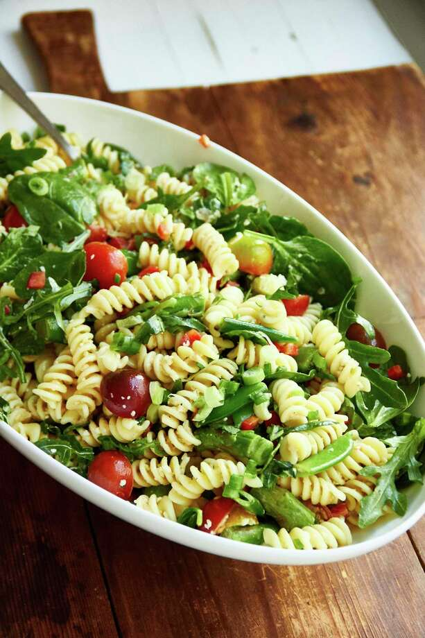 This February 2018 photo shows simple vegetarian spring pasta salad in New York. In this recipe, the asparagus and sugar snap peas get a bit more tender and keep their bright green color after a quick simmer, and the best part is that you can add them right into the pasta at the end of the cooking time. (Mia via AP) Photo: Mia / Mia Via Katie Workman