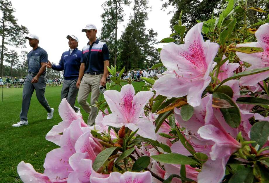 Tiger Woods, Fred Couples and Matt Parziale walk on the sixth hole during a practice round for the Masters golf tournament Wednesday, April 4, 2018, in Augusta, Ga. (AP Photo/David J. Phillip) Photo: David J. Phillip, STF / Associated Press