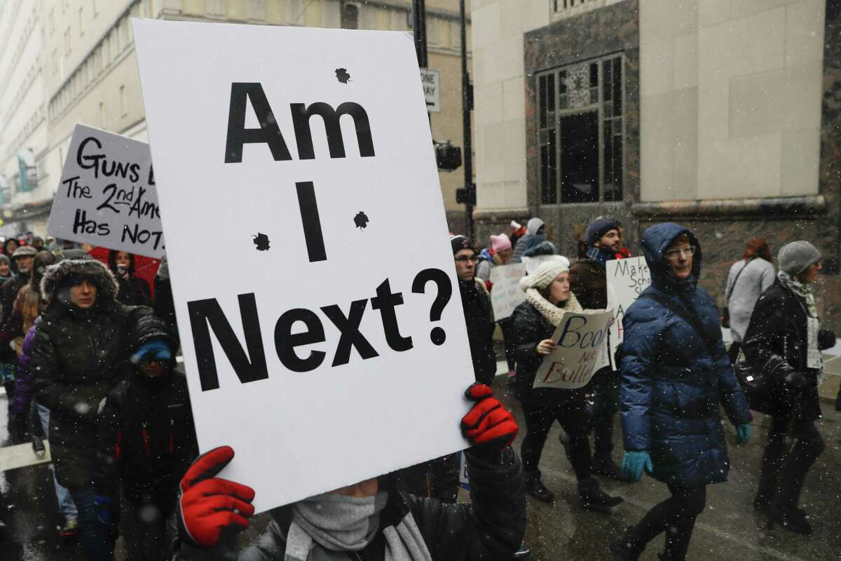 Demonstrators march through downtown Cincinnati during the March for Our Lives protest on March 24.