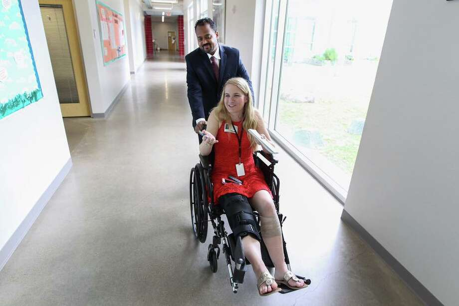 The author on an assignment for the Houston Chronicle, about a month after breaking her femur.
