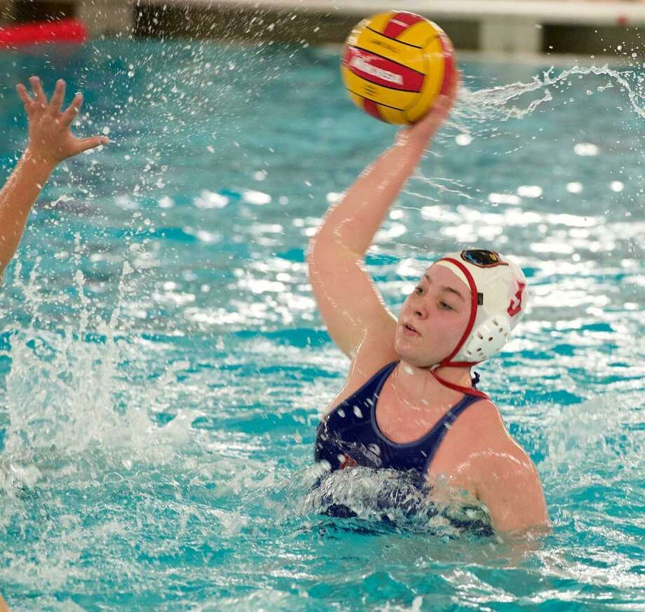Greenwich High sophomore Charlotte Hallisey gets ready to take a shot during the Cardinals' water polo match against Greenwich Academy on Tuesday at Greenwich High School. Photo: Photo Courtesy / Susan Carlson