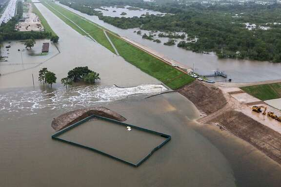 Water is released from the Barker Reservoir in the aftermath of Tropical Storm Harvey on Tuesday, Aug. 29, 2017, in Houston. ( Brett Coomer / Houston Chronicle )