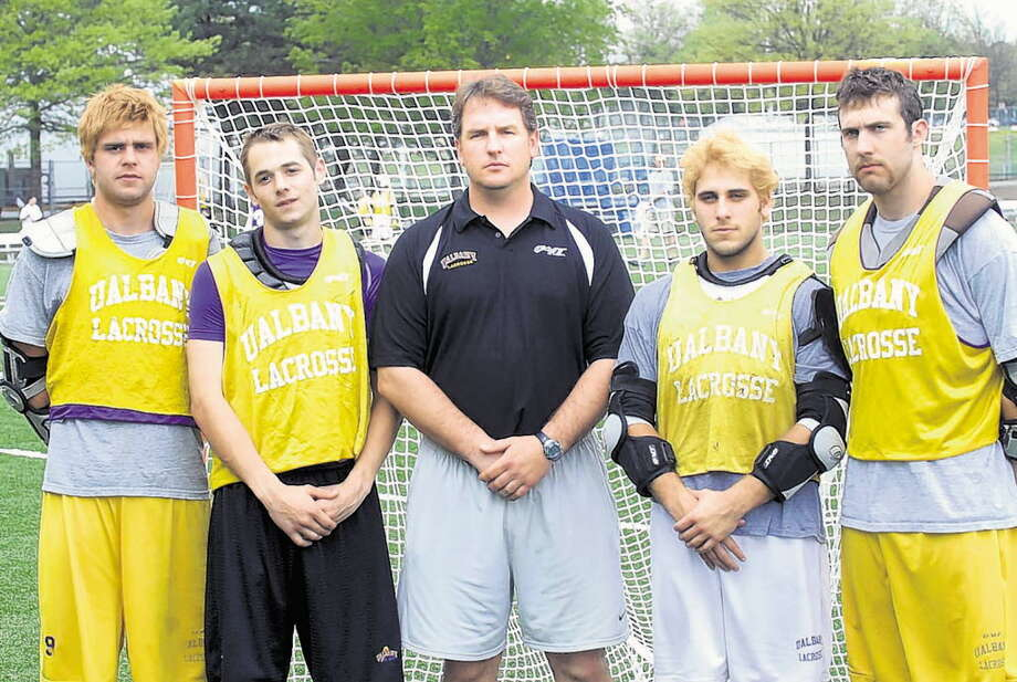 The 2007 UAlbany men's lacrosse team reached the NCAA quarterfinals for the first time with (from left to right) Merrick Thomson, Brett Queener, head coach Scott Marr, Jordan Levine and Frank Resetarits. (Times Union file photo)