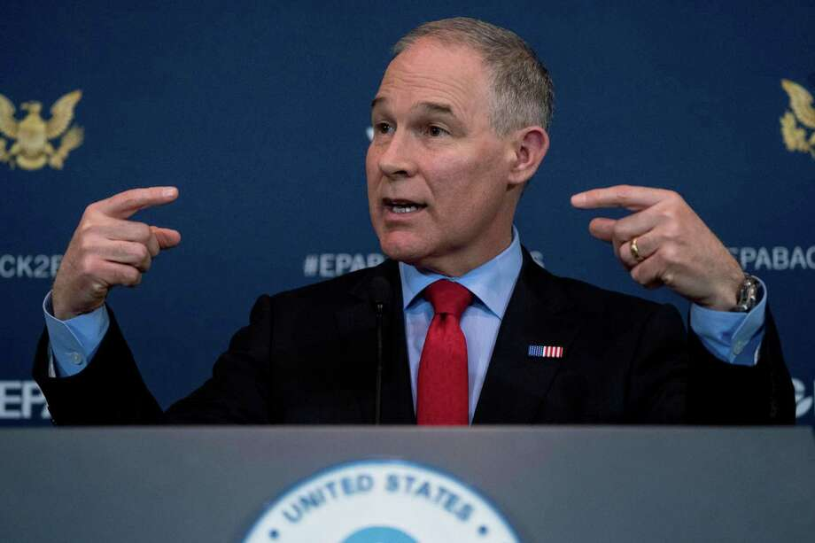 FILE - In this April 3, 2018 file photo Environmental Protection Agency Administrator Scott Pruitt speaks at a news conference at the Environmental Protection Agency in Washington. Pruitt indicated this week he may target a longstanding federal waiver that allows California to set its own, tougher tailpipe emission standards, an exception that's allowed the state to prod the rest of nation to do more against air pollution and climate change for a half-century. (AP Photo/Andrew Harnik,File) Photo: Andrew Harnik, STF / Associated Press / Copyright 2018 The Associated Press. All rights reserved.