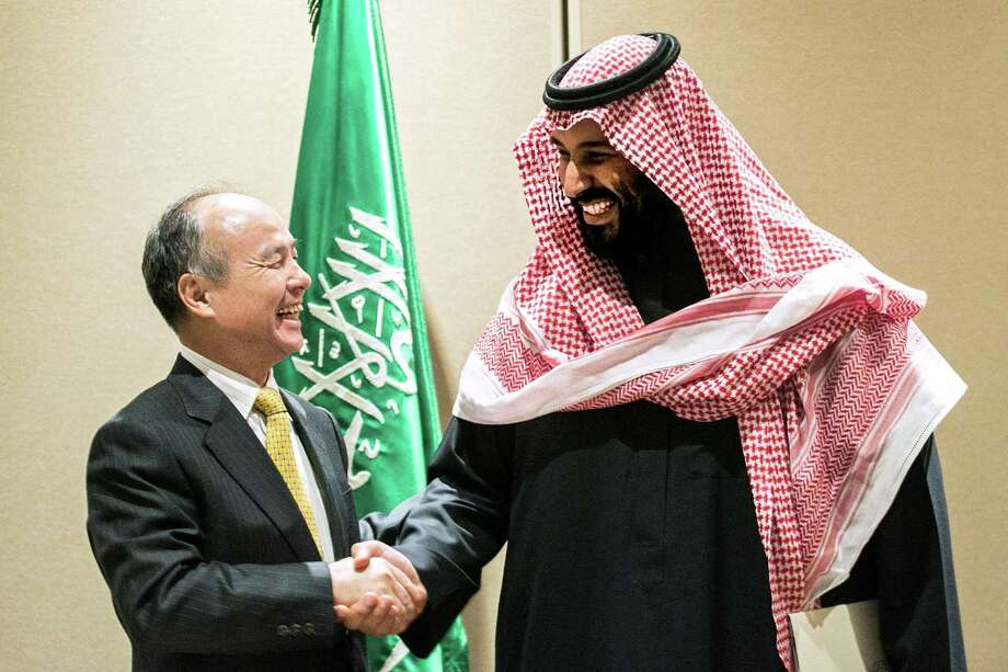 Masayoshi Son, chairman and chief executive officer of SoftBank Group Corp. (left) shakes hands with Mohammed bin Salman, Saudi Arabia's crown prince, in New York on March 27, 2018. MUST CREDIT: Bloomberg photo by Jeenah Moon. Photo: Jeenah Moon / Bloomberg / © 2018 Bloomberg Finance LP