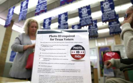A sign tells 2016 voters of voter ID requirements before participating in the primary election at Sherrod Elementary school in Arlington, Texas. A Mexican national sentenced to eight years in prison for voter fraud in Texas says she was wrongly used by authorities as an example of fraud. Rosa Maria Ortega, who was brought to Texas as an infant, says she held a green card and always believed she was allowed to vote.