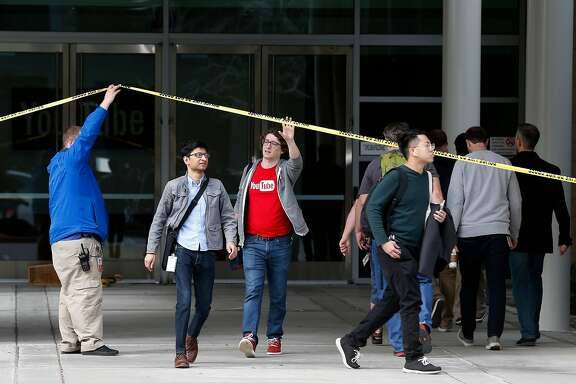 Employees leave YouTube headquarters after being allowed to briefly enter the building in San Bruno, Calif. on Wednesday, April 4, 2018. On Tuesday, disgruntled video maker Nasim Aghdam shot and wounded three YouTube employees before turning the gun on herself.