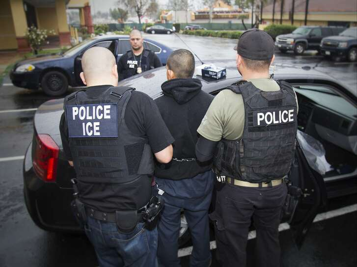 FILE - In this Feb. 7, 2017, photo released by U.S. Immigration and Customs Enforcement, foreign nationals are arrested during a targeted enforcement operation conducted by U.S. Immigration and Customs Enforcement (ICE) aimed at immigration fugitives, re-entrants and at-large criminal aliens in Los Angeles. Federal immigration agents arrested 115 people during a three-day operation in the San Diego area amid heightened tensions between the Trump administration and the state of California over immigration enforcement. (Charles Reed/U.S. Immigration and Customs Enforcement via AP, File)