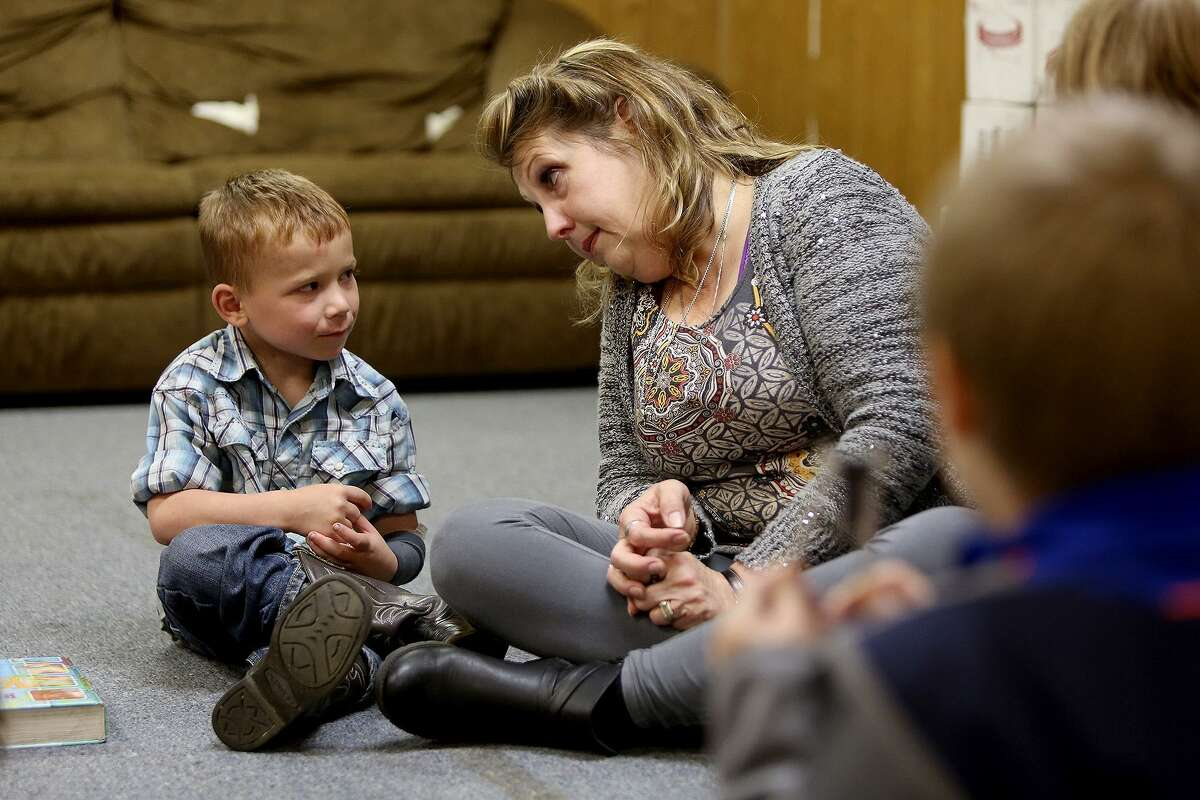 Julie Workman looks to Ryland Ward, 6, as she leads the children's Bible study at First Baptist Church of Sutherland Springs on Thursday, March 8, 2018.